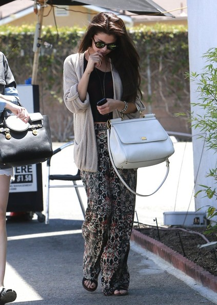 Selena wore big and bold printed pants while out grabbing lunch with a friend.