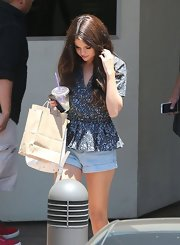 Selena looked pretty in this patterned peplum top while out in California.