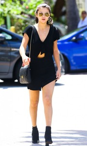 Selena Gomez toughened up her look with a pair of black ankle boots.