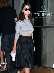 Selena Gomez stepped out in New York City wearing cool Dior sunglasses with a crop-top and a leather skirt.