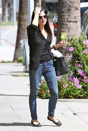 Selma Blair opted for a black cardigan for her daytime look while out with friends.
