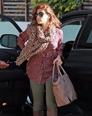 Eva Mendes arrived at the  Kinara Skin Care Clinic and Spa in West Hollywood wearing a flowing animal print scarf over a floral blouse.