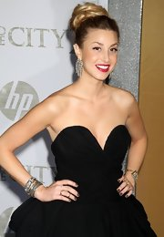 Whitney port paired her diamond drop earrings with an arm full of diamond bangles.