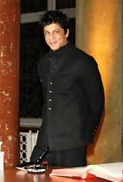 Shahrukh Khan was a style star in his black mandarin-collar jacket when he signed Berlin's Golden Book.