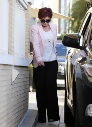 Sharon Osbourne arrived at Barney's NYC wearing a pink blazer and a pair of wide-leg pants.
