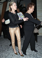 Sharon Stone donned pointy leopard print pumps with a pair of beige leather pants.