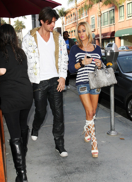 Shauna Sand was out and about in LA wearing a pair of distressed jean shorts with a striped sweater and gladiator heels.