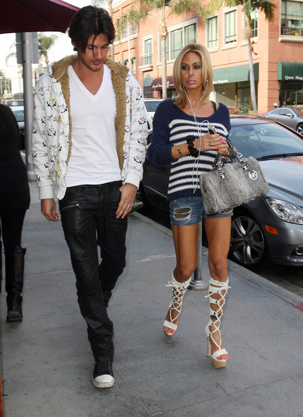 Shauna Sand's white gladiator heels were the highlight of her casual ensemble.