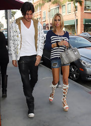 Shauna Sand looked relaxed in a blue and white striped scoopneck sweater and denim cutoffs while out and about in LA.