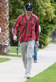Shia keeps things casual and comfy in a lumberjack inspired red and gray flannel.