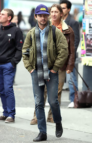 Shia LaBeouf blended in with the crowd in his olive bomber jacket and jeans.