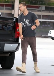 Shia wore a pair of dark brown skinny pants with lace-up boots for a casual but hip look.