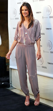 If anyone can rock a tie-dye jumpsuit, it's Alessandra Ambrosio.