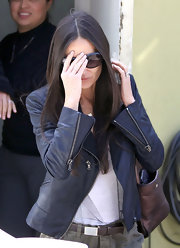 Demi Moore went out for lunch in Brentwood wearing a leather jacket and black shades.
