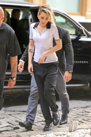 Kristen Stewart paired her top with baggy black slacks.