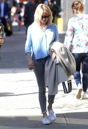 For her footwear, Sienna Miller chose classic white canvas sneakers by Superga.