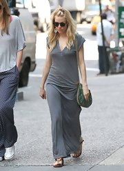 Sienna Miller opted for a long gray maxi for her casual look while out in NYC.