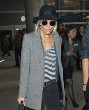 Sienna Miller tried to go incognito in a black walker hat and a pair of shades while making her way through LAX.