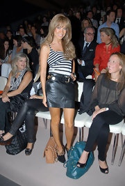 Sylvie van der Vaart posed at the Javier Larrainzer fashion show in cute black and leopard print ankle booties by Christian Louboutin.