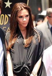 Victoria Beckham kept her hairstyle simple at Simon Fuller's Hollywood Walk of Fame Ceremony. She left her locks long and straight for a slightly edgy effect.
