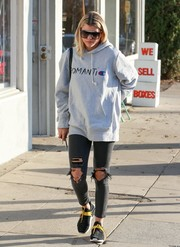 Sofia Richie took a stroll in West Hollywood wearing a Champion For Wood Wood 'Romantic' hoodie.