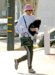 Sofia Richie completed her outfit with a pair of checkered loafer mules by Givenchy.