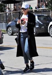 Sofia Richie teamed black-and-white sneakers with jeans and a coat for a day out in West Hollywood.