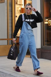 Sofia Richie teamed her sweater with baggy, half-undone overalls.