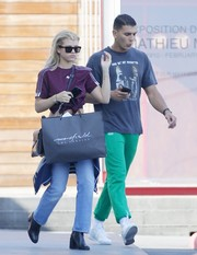 Sofia Richie went sporty in a purple Adidas Originals x Alexander Wang soccer tee while out shopping.