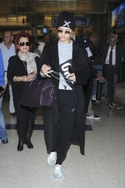 Sofia Richie sealed off her airport look with a pair of Adidas Yeezy Boost 350 sneakers.