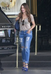 Sofia Vergara gave her casual getup a glam punch with a pair of cobalt Saint Laurent Tribute sandals.