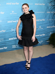 Lorraine is a doll in a ruffled crisp black cocktail dress at the 'Soul Surfer' premiere.
