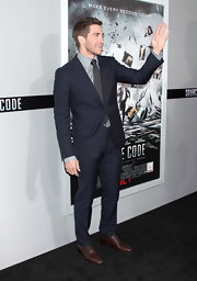 Jake looks dapper in a navy suit and brown wingtips at the 'Source Code' premiere.