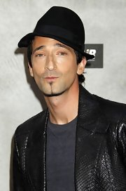 Adrien Brody paired his leather jacket with a relaxed fedora hat.
