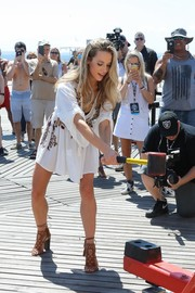 Hannah Ferguson rocked a pair of brown gladiator heels with her coverup during the SI Summer of Swim Fan Festival.
