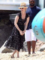 January Jones looked girly in a cap-sleeve print dress during Joel Silver's Memorial Day party.