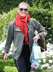 Molly Sims chose a stylish but casual army green utility jacket for her cool daytime look.