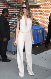 Rosie paired her plunging top with a nude trousers from the Fall 2011 collection.