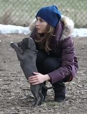 Noomi Rapace bundled up with a blue knit beanie and a down jacket while filming 'Animal Rescue' in NYC.