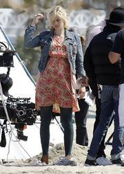 Georgia King paired a cool denim jacket with her floral dress for a dressed down look.