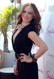 Karina Smirnoff completed her plunging jumpsuit with a large bangle bracelet.