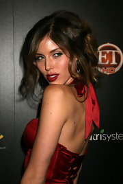 This messy, curled updo is fun and flirty and perfect for a sexy red dress.