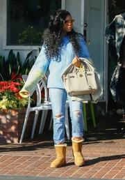 Taraji P. Henson chose a pair of ripped jeans to team with her sweater.