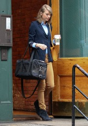 Taylor Swift was preppy in a navy blazer teamed with tan skinny jeans while out in New York City.