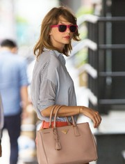 Taylor Swift looked cool and cute in her pink wayfarers while out and about in New York City.