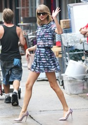 Taylor Swift left the gym wearing a boxy floral-and-stripe blouse by H&M.