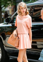 Taylor Swift kept her look youthful with a flared peach mini skirt.