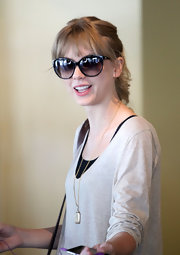 Taylor Swift framed her girl next door looks with a pair of oversize cateyes.