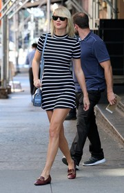 Taylor Swift opted for a casual yet sophisticated look with her striped mini dress while out in NYC.