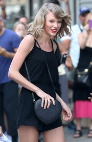 Taylor Swift sported a sweet after-gym look with this heart-shaped snakeskin bag and romper combo.